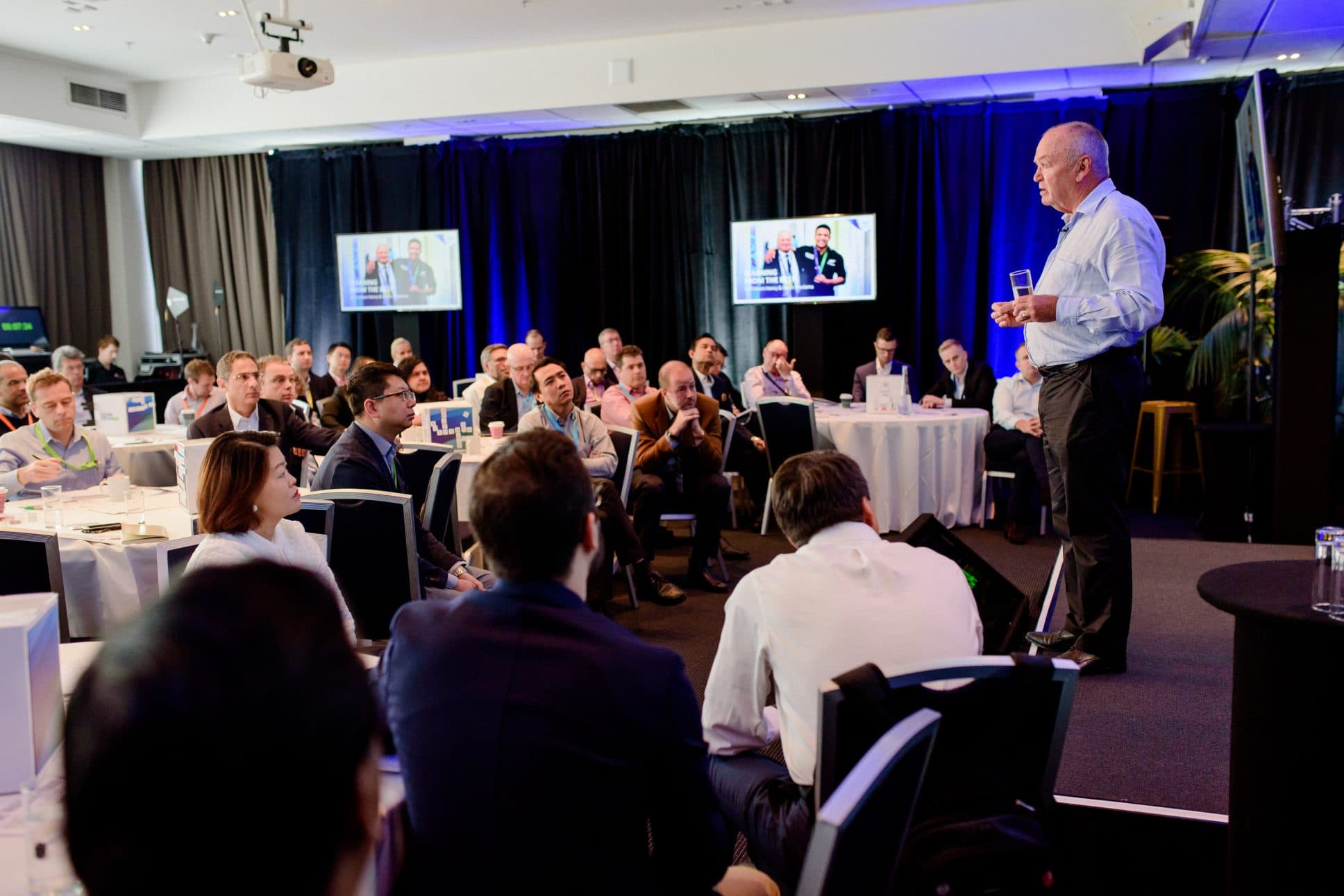 Graham Henry speaking at event at Rydges Auckland.