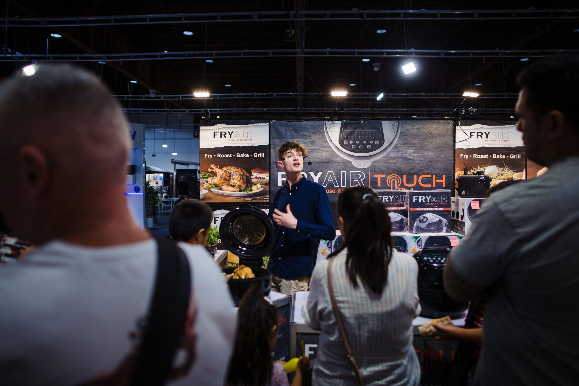 Man talking to crowd at Auckland Home Improvement expo at ASB showgrounds