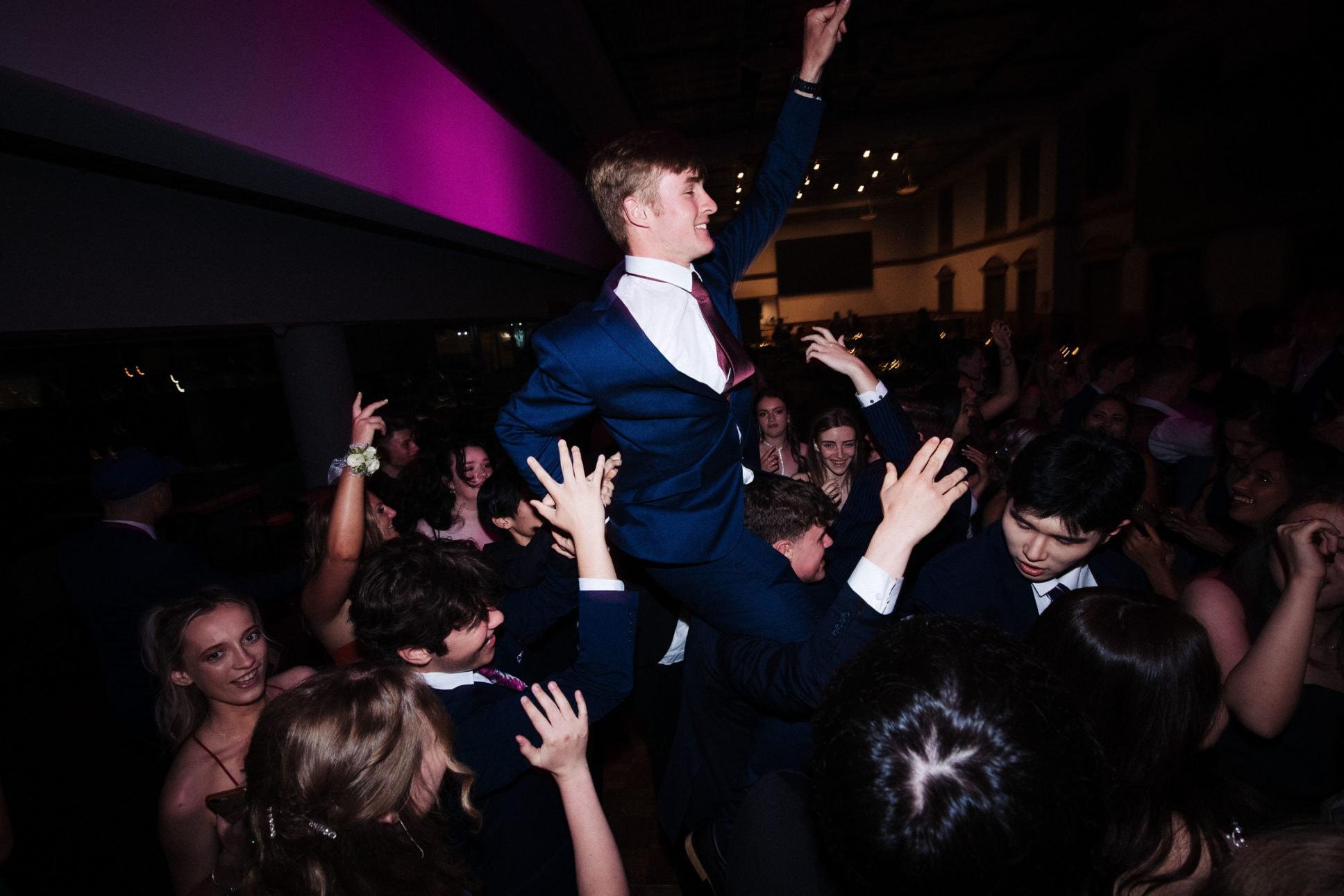 Fun on dance floor at school ball held at Auckland's Eden Park.