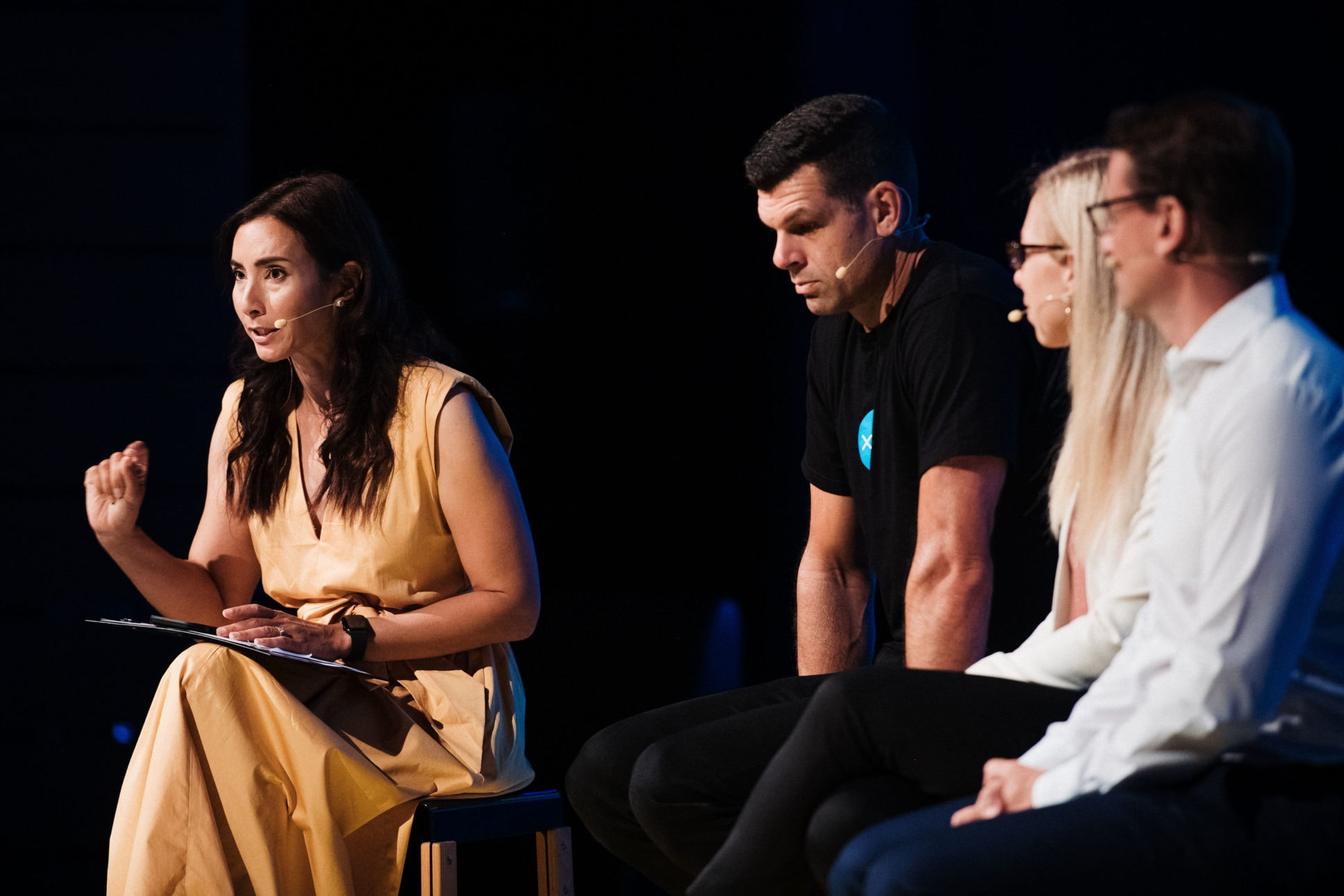 panelist discuss stories from Silver Linings at ASB Waterfront theatre event